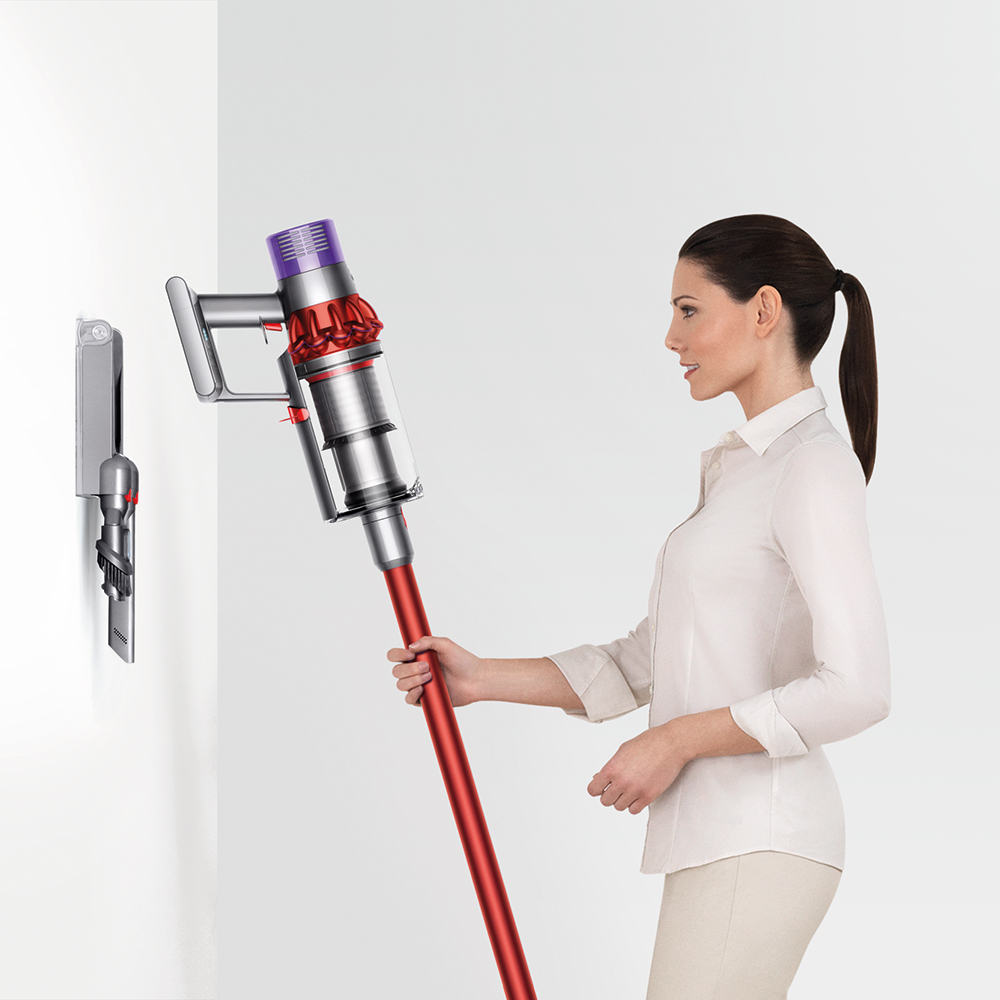 The Dyson Cyclone V10™ vacuum drops into the wall-mounted dock, to recharge and to tidily store the tools, ready to grab and go.